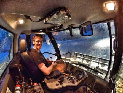photo: Zach Collins driving a snowcat.